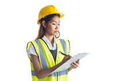Architect woman with yellow helmet and plans Royalty Free Stock Images