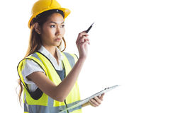 Architect woman with yellow helmet and plans Royalty Free Stock Image
