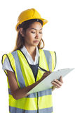 Architect woman with yellow helmet and plans Royalty Free Stock Photos