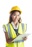 Architect woman with yellow helmet and plans Stock Photography