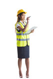 Architect woman with yellow helmet and plans Stock Image
