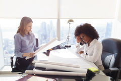 Architect Women Colleagues With Blueprints Examining Housing Pro Stock Photography