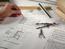 Architect at Work. An architect design his new construction project Stock Photos