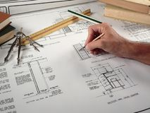 Architect at Work. With his design Stock Images