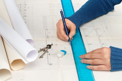 Architect at work. Architect draws a factory building plan Royalty Free Stock Photo