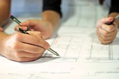 Architect during work. Hands of an architect during work Stock Photos