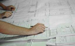 Architect during work. Hands of an architect during work Stock Images
