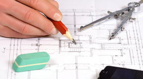 Architect work with blue print Royalty Free Stock Image
