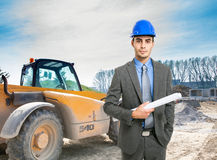 Architect at work in a construction site Stock Photo