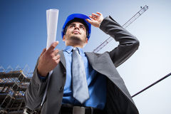 Architect at work in a construction site Stock Image