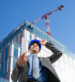 Architect at work in a construction site Royalty Free Stock Image