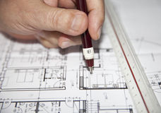 Architect Work. Architect drawing house architecture plans Royalty Free Stock Images