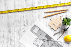 Architect at work. Drawing and tools on light wooden desk top view copyspace Royalty Free Stock Photo