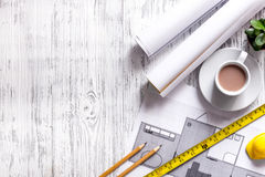 Architect at work. Drawing and tools on light wooden desk top view copyspace Stock Photography
