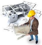 Architect, work in progress. Architect looking at his plans with a roofless office / apartment structure Stock Photos