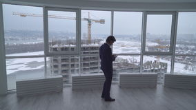 Architect at work use mobile stock footage