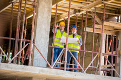 Architect and worker in building construction Royalty Free Stock Photo