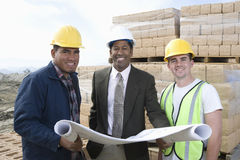 Architect And Workers With Blueprint Stock Photos