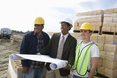 Architect And Workers At Construction Site Stock Images