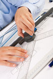 Architect working on architectural plans Royalty Free Stock Photography