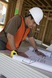 Architect Working On Blueprint royalty free stock image