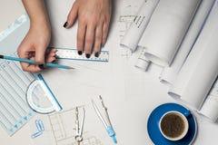 Architect Working On Blueprint Stock Afbeeldingen