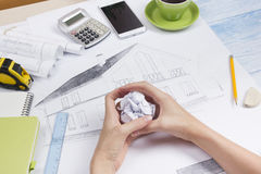 Architect working on blueprint. Architects workplace - architectural project, blueprints, ruler, calculator, laptop and Royalty Free Stock Image
