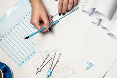Architect working on blueprint. Royalty Free Stock Image