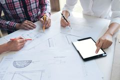 Architect working on blueprint, Engineer meeting working with pa. Rtner colleagues and engineering tools for architectural project, Construction concept Royalty Free Stock Photo