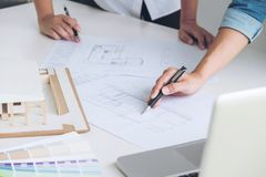 Architect working on blueprint, Engineer meeting working with pa. Rtner colleagues and engineering tools for architectural project, Construction concept stock photos