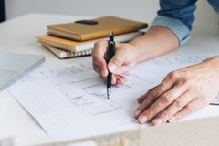 Architect working on blueprint, Engineer working with engineering tools for architectural project on workplace, Construction. Concept - building project royalty free stock image