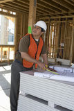 Architect Working On Blueprint At Site Royalty Free Stock Photography