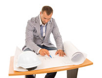Architect working on a blueprint Stock Photo