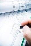Architect working on blueprints Stock Photography