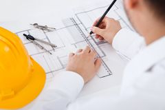 Architect working on blueprints Stock Photos