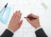 Architect working on project. Architect working on blueprints from above Stock Image