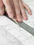 Architect working on a bluprint stock images