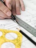 Architect working on a bluprint Royalty Free Stock Image