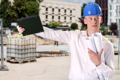 Architect working on the building site Stock Photography