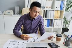 Architect working on construction project Stock Photography
