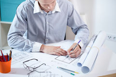 Architect working on his project. Stock Image