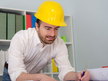 Architect working on his projects papers Stock Photo
