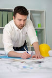 Architect working on his projects. Papers in the office Stock Images