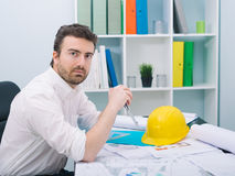 Architect working on his projects. Papers in the office Royalty Free Stock Photos