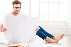 Architect working at home. Stock Images