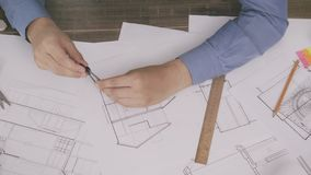 Architect working on a house plan. Stock footage stock footage