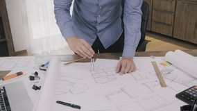 Architect working on a house plan. Stock footage stock video footage