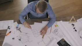 Architect working on a house plan. Stock footage stock video
