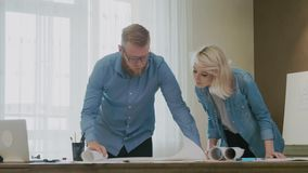 Architects working on a house plan. Architect working on a house plan stock footage stock footage