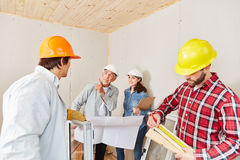 Architect working on house renovation. And planning as team with artisans stock photography